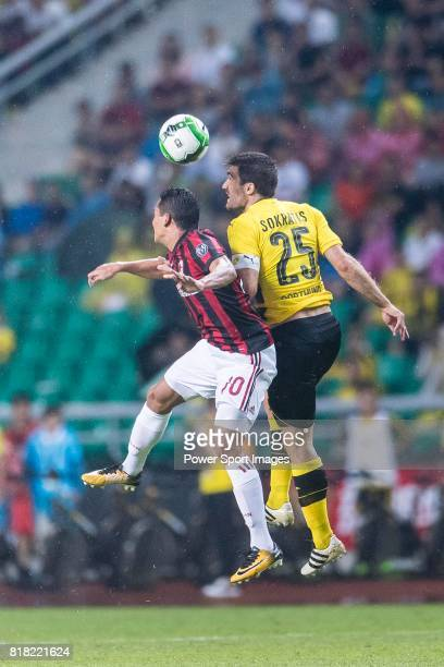 Milan Forward Carlos Bacca fights for the ball with Borussia Dortmund Defender Sokratis Papastathopoulos during the International Champions Cup 2017...