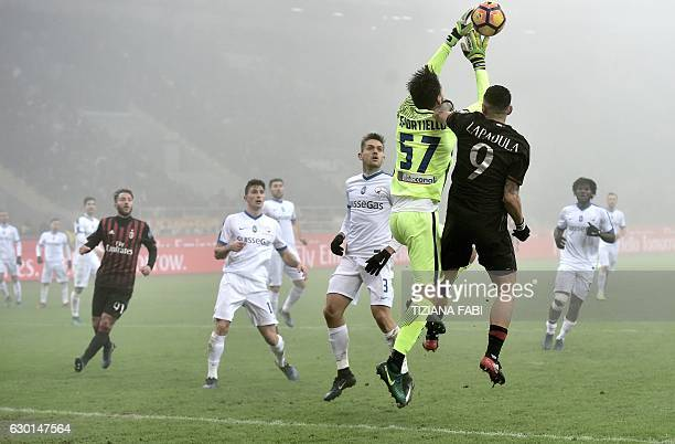 AC Milan forward from Italy Gianluca Lapadula jumps for the ball with Atalanta's goalkeeper from Italy Marco Sportiello during the Serie A football...