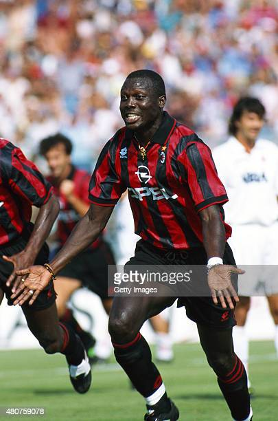 Milan forward George Weah celebrates after scoring during a Serie A match between Padova and Milan on August 27 1995 in Italy