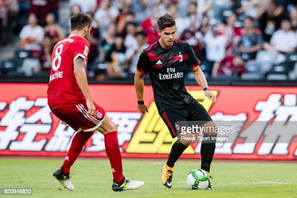 Milan Forward Gianluca Lapadula plays against Bayern Munich Midfielder Javi Martinez during the 2017 International Champions Cup China match between...