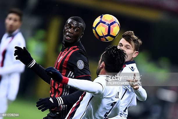 AC Milan forward of France M'Baye Niang vies with Cagliari midfielder from Chile Mauricio Isla during the Italian Serie A football match AC Milan vs...