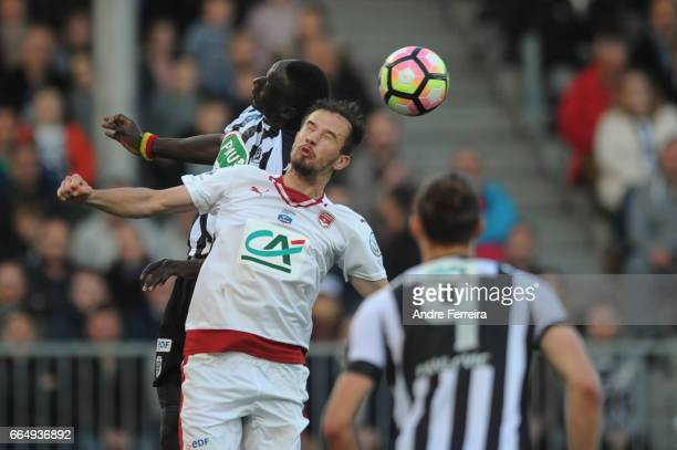 Milan Gajic of Bordeaux and Famara Diedhiou of Angers during the French National Cup Quarter Final match between SCO Angers and Girondins Bordeaux on...