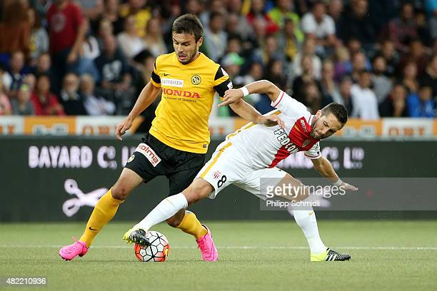 Milan Gajic of BSC Young Boys fights for the ball with Joao Moutinho of AS Monaco during the UEFA Champions League third qualifying round 1st leg...