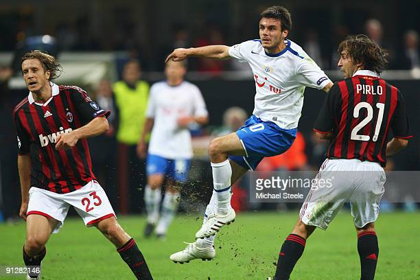 Milan Gajic of Zurich shoots as Massimo Ambrosini and Andrea Pirlo look on during the UEFA Champions League Group C match between AC Milan and FC...