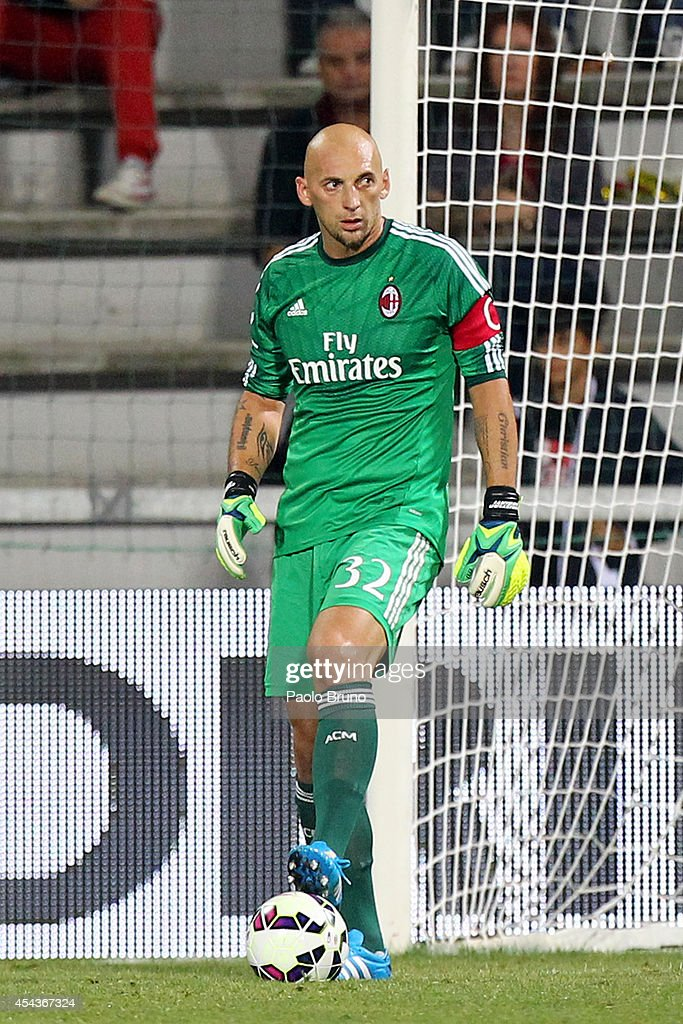 AC Milan goalkeeper <a gi-track='captionPersonalityLinkClicked' href=/galleries/search?phrase=Christian+Abbiati&family=editorial&specificpeople=2158791 ng-click='$event.stopPropagation()'>Christian Abbiati</a> in action during the TIM Pre-season Tournament between US Sassuolo, FC Juventus and AC Milan at Mapei Stadium - Citta' del Tricolore on August 23, 2014 in Reggio nell'Emilia, Italy.