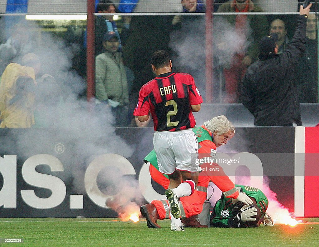 Milan goalkeeper Dida is struck by a flare during the UEFA Champions League quarterfinal second leg between AC Milan and Inter Milan at the San Siro...
