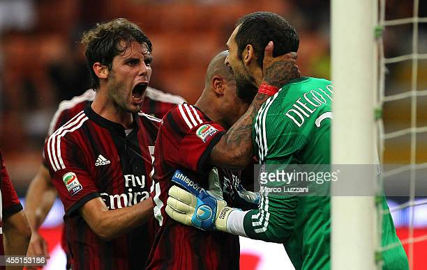 Milan goalkeeper Diego Lopez celebrates with his teammates Nigel De Jong and Andrea Poli after saving a penalty during the Serie A match between AC...