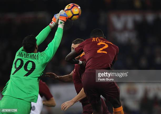 Milan goalkeeper Gianluigi Donnarumma competes for the ball with Antonio Rudiger of AS Roma during the Serie A match between AS Roma and AC Milan at...