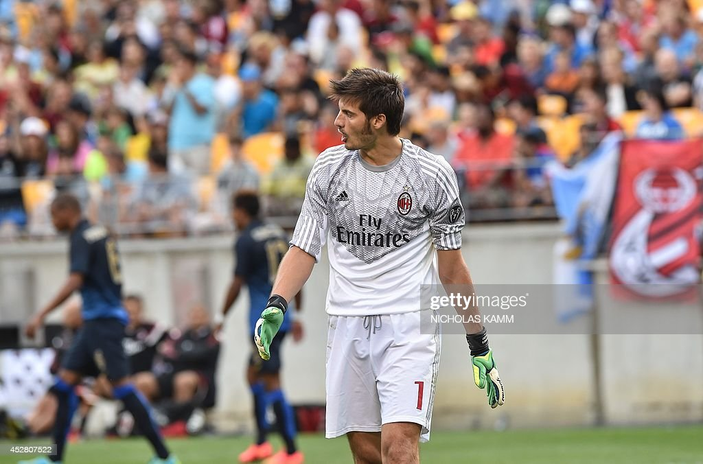 AC Milan goalkeeper Michael Agazzi reacts after conceding a fifth goal against Manchester City during a Champions Cup match at Heinz Field in Pittsburgh on July 27, 2014. Manchester City won 5-1. AFP PHOTO/Nicholas KAMM