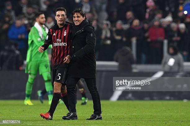 Milan head coach Vincenzo Montella and Giacomo Bonaventura reacts at the end of the TIM Cup match between Juventus FC and AC Milan at Juventus...