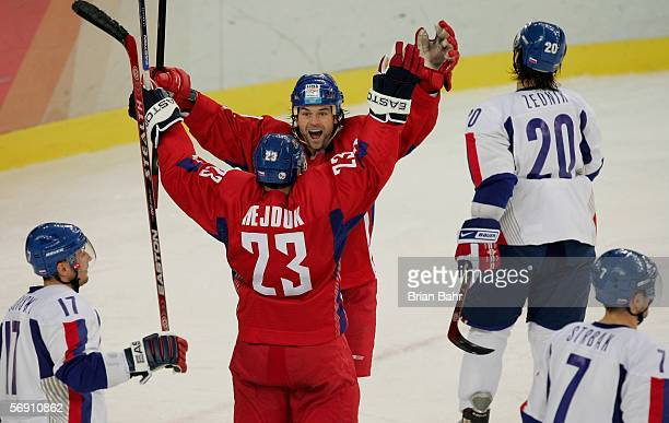 Milan Hejduk of Czech Republic celebrates with his teammates Robert Lang after he scored the second goal during the quarter final of the men's ice...