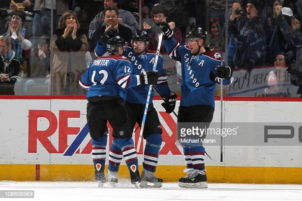 Milan Hejduk of the Colorado Avalanche celebrates his second period goal against the Minnesota Wild with teammates Kevin Porter and Paul Stastny at...