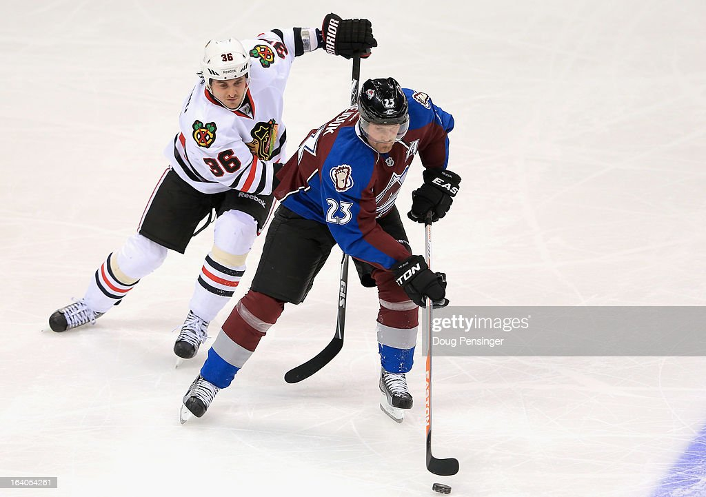 Milan Hejduk #23 of the Colorado Avalanche controls the puck against Dave Bolland #36 of the Chicago Blackhawks at the Pepsi Center on March 18, 2013 in Denver, Colorado. The Blackhawks defeated the Avalanche 5-2.