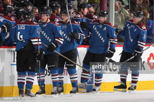 Milan Hejduk of the Colorado Avalanche second from right celebrates his second period goal against the Minnesota Wild with teammates JohnMichael...