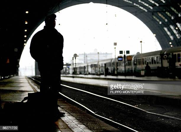 A man waits for a train on an empty platform in Milan's Central station 25 November 2005 Transportation throughout italy is on strike to protest...