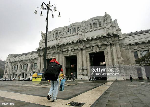 A man walks towards Milan's central station 25 November 2005 From Venice to Palermo life in Italy was severely disrupted Friday as workers walked out...