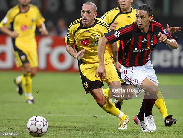 AC Milan's Brazilian forward Ricardo Oliveira fights for the ball with AEK Athens' defender Bruno Cirillo of Italy during their Champions League...