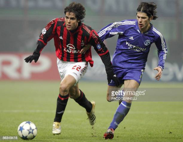 AC Milan's midfielder Kaka fights for the ball with FC Schalke 04's defender Levan Kobiashvili during their first leg group E Champions League...