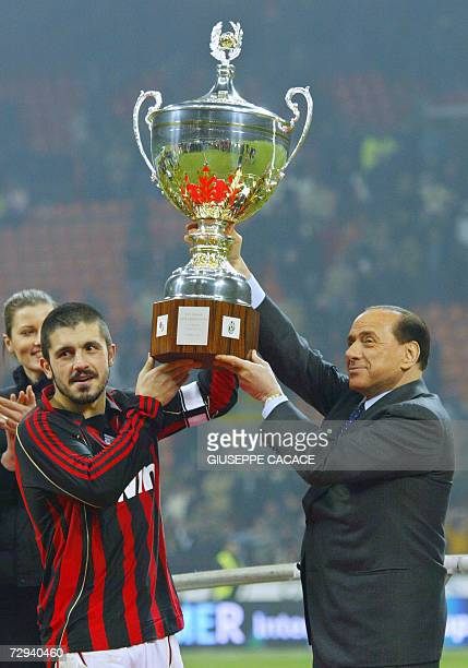 AC Milan's president Silvio Berlusconi and AC Milan midfielder Gennaro Gattuso hold the Cup after Berlusconi trophy between Juventus and AC Milan at...