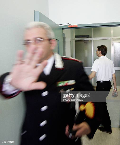 An Italian carabiniere leaves 28 June 2006 the intensive care unit of the Molinette hospital in Turin where former Italy international and Juventus...