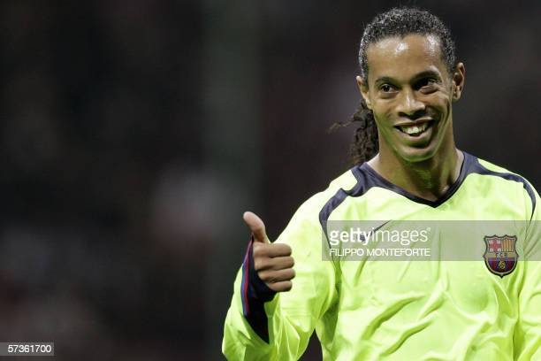 Barcelona's midfielder Ronaldinho of Brazil celebrates after his teammate Ludovic Giuly of France scored against AC Milan during semifinals first leg...