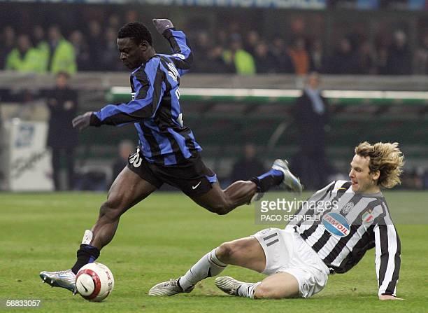 Inter Milan forward Obafemi Martins vies with Juventus midfielder Pavel Nedved during their serie A football match Inter MilanJuventus at San Siro...