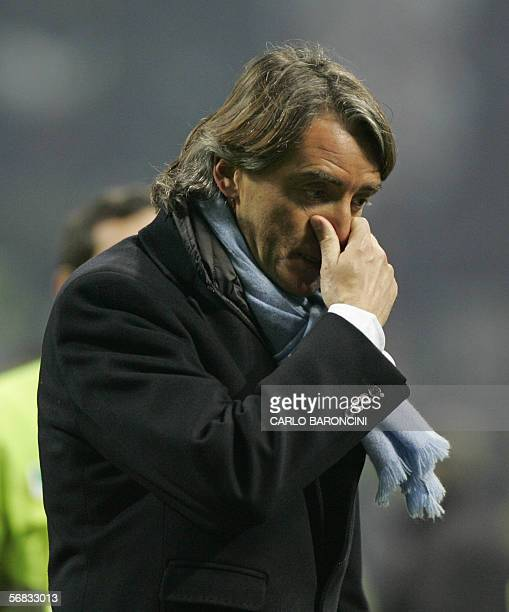 Inter Milan trainer Roberto Mancini leaves the pitch at the end of an Italian serie A football match against Juventus at Giuseppe Meazza stadium in...