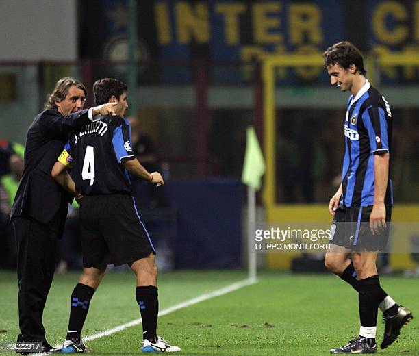 Inter Milan's coach Roberto Mancini gestures to Javier Zanetti as Zlatan Ibahimovic walks out of the pitch after been sent off during their Champions...