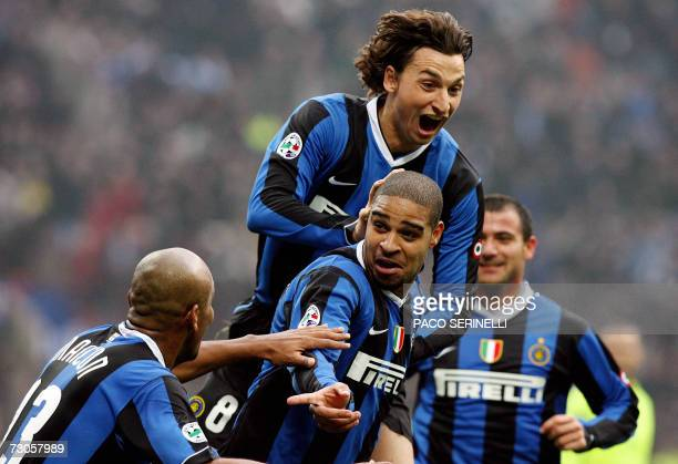 Inter Milan's forward Adriano is congratulated by his teammates Maicon Zlatan Ibrahiomovic and Dejan Stankovic after scoring a goal against...
