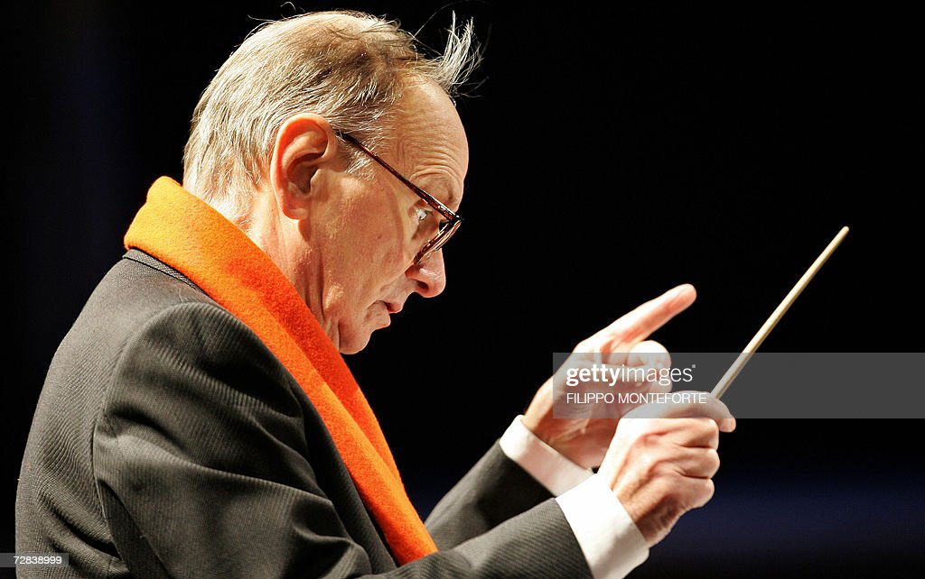 Italian composer <a gi-track='captionPersonalityLinkClicked' href=/galleries/search?phrase=Ennio+Morricone&family=editorial&specificpeople=677347 ng-click='$event.stopPropagation()'>Ennio Morricone</a> conducts the Christmas concert in Milan's Piazza Duomo 16 December 2006. Morricone, the man behind the memorable music used in Sergio Leone's spaghetti westerns, will be presented with an honorary Oscar at the 2007 Oscars in Hollywood, 25 February 2007. AFP PHOTO / Filippo MONTEFORTE