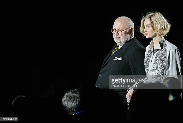 Italian designer Gianfranco Ferre acknowledges the audience with Italian model Eva Riccobono at the end of his show during the Fall / Winter...