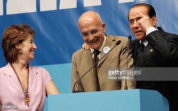 Italian former prime minister Silvio Berlusconi jokes with Milan mayor Gabriele Albertini and Letizia Moratti during the closing of Letizia Moratti's...
