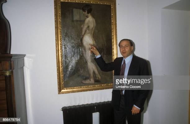 Milan Italy Silvio Berlusconi joking with a nude female painting