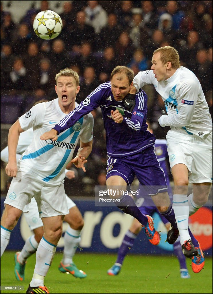 <a gi-track='captionPersonalityLinkClicked' href=/galleries/search?phrase=Milan+Jovanovic&family=editorial&specificpeople=3534424 ng-click='$event.stopPropagation()'>Milan Jovanovic</a> of RSC Anderlecht (C) is challenged during the UEFA Champions League Group C match between RSC Anderlecht and FC Zenit St Petersburg at the Constant Vanden Stock Stadium on November 6, 2012 in Brussels, Belgium.