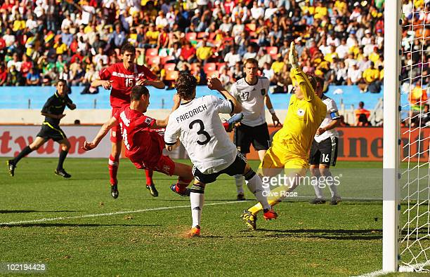 Milan Jovanovic of Serbia scores the first goal past goalkeeper Manuel Neuer and Arne Friedrich of Germany during the 2010 FIFA World Cup South...
