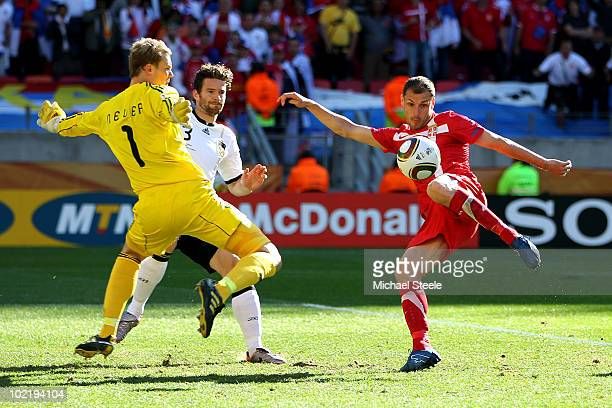 Milan Jovanovic of Serbia scores the first goal past Manuel Neuer of Germany during the 2010 FIFA World Cup South Africa Group D match between...