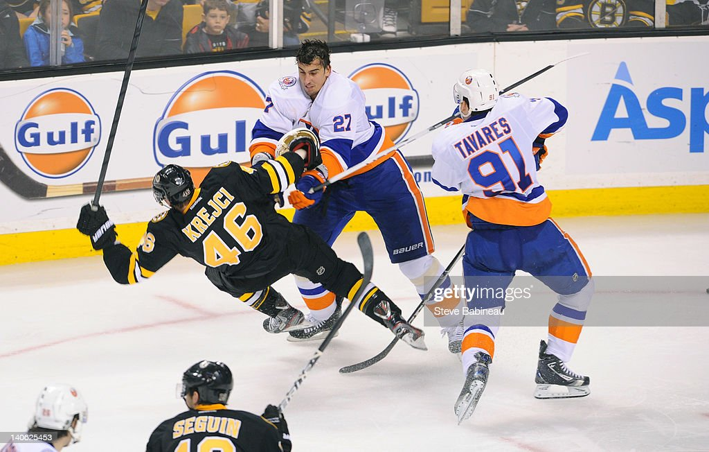 <a gi-track='captionPersonalityLinkClicked' href=/galleries/search?phrase=Milan+Jurcina&family=editorial&specificpeople=243187 ng-click='$event.stopPropagation()'>Milan Jurcina</a> #27 of the New York Islanders checks against <a gi-track='captionPersonalityLinkClicked' href=/galleries/search?phrase=David+Krejci&family=editorial&specificpeople=722556 ng-click='$event.stopPropagation()'>David Krejci</a> #46 of the Boston Bruins at the TD Garden on March 3, 2012 in Boston, Massachusetts.