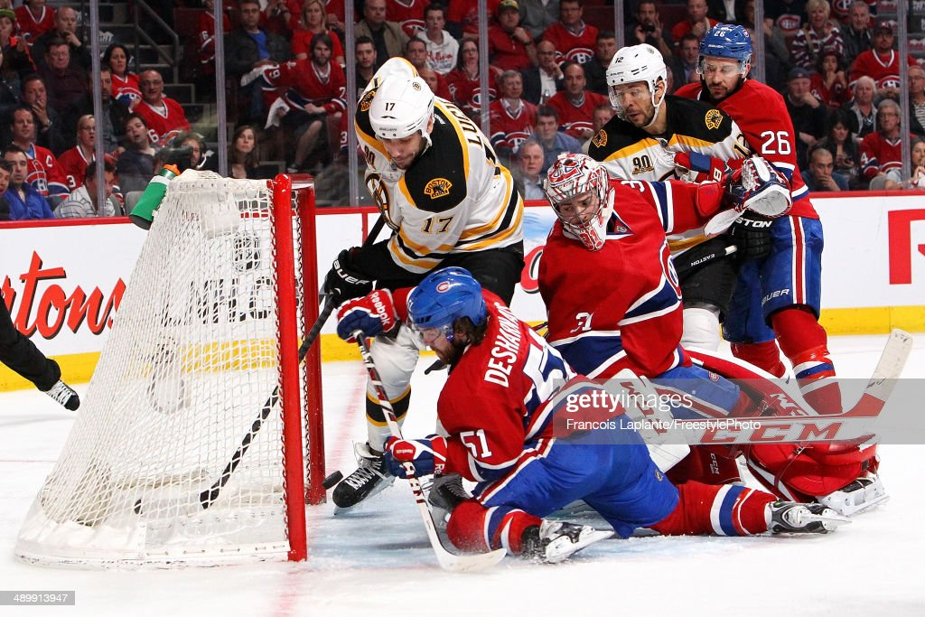 Milan Lucic #17 and Jarome Iginla #12 of the Boston Bruins battle for a loose puck against goalie Carey Price #31, Josh Gorges #26 and David Desharnais #51 of the Montreal Canadiens in Game Six of the Second Round of the 2014 NHL Stanley Cup Playoffs at the Bell Centre on May 12, 2014 in Montreal, Quebec, Canada.