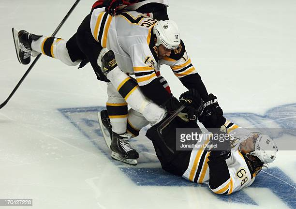 Milan Lucic and Jaromir Jagr of the Boston Bruins collide against the Chicago Blackhawks during Game One of the 2013 NHL Stanley Cup Finals at United...