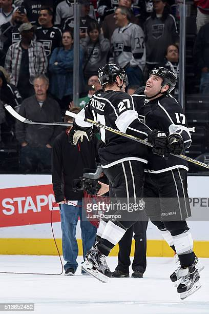 Milan Lucic chest bumps Alec Martinez of the Los Angeles Kings after their win against the Montreal Canadiens on March 3 2016 at Staples Center in...