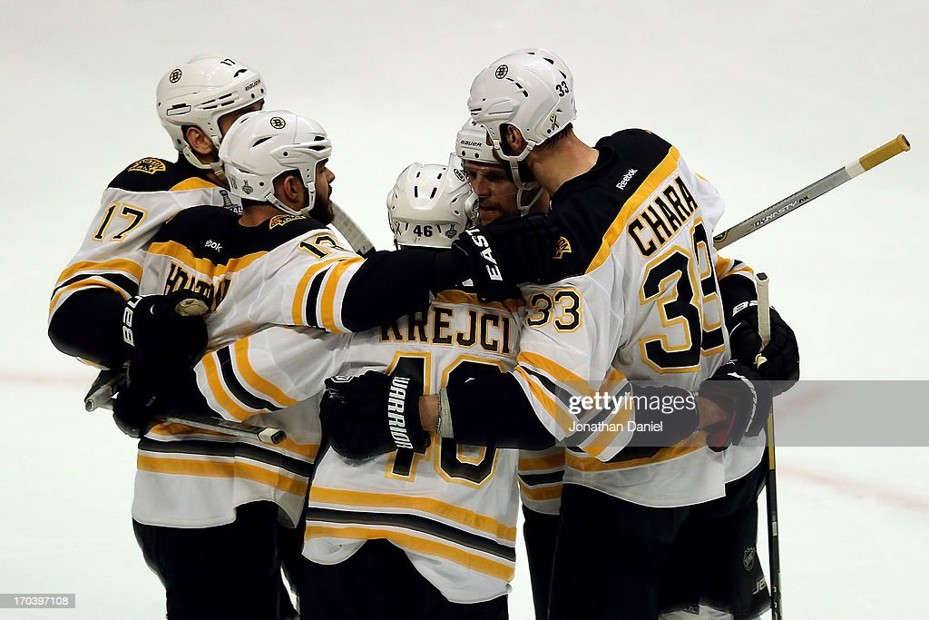 <a gi-track='captionPersonalityLinkClicked' href=/galleries/search?phrase=Milan+Lucic&family=editorial&specificpeople=537957 ng-click='$event.stopPropagation()'>Milan Lucic</a> #17, <a gi-track='captionPersonalityLinkClicked' href=/galleries/search?phrase=Nathan+Horton&family=editorial&specificpeople=204741 ng-click='$event.stopPropagation()'>Nathan Horton</a> #18, <a gi-track='captionPersonalityLinkClicked' href=/galleries/search?phrase=David+Krejci&family=editorial&specificpeople=722556 ng-click='$event.stopPropagation()'>David Krejci</a> #46, <a gi-track='captionPersonalityLinkClicked' href=/galleries/search?phrase=Dennis+Seidenberg&family=editorial&specificpeople=204616 ng-click='$event.stopPropagation()'>Dennis Seidenberg</a> #44 and Zdeno Chara #33 of the Boston Bruins celebrate after Lucic scored a goal in the first period against the Chicago Blackhawks in Game One of the 2013 NHL Stanley Cup Final at United Center on June 12, 2013 in Chicago, Illinois.