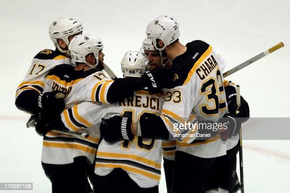 Milan Lucic Nathan Horton David Krejci Dennis Seidenberg and Zdeno Chara of the Boston Bruins celebrate after Lucic scored a goal in the first period...