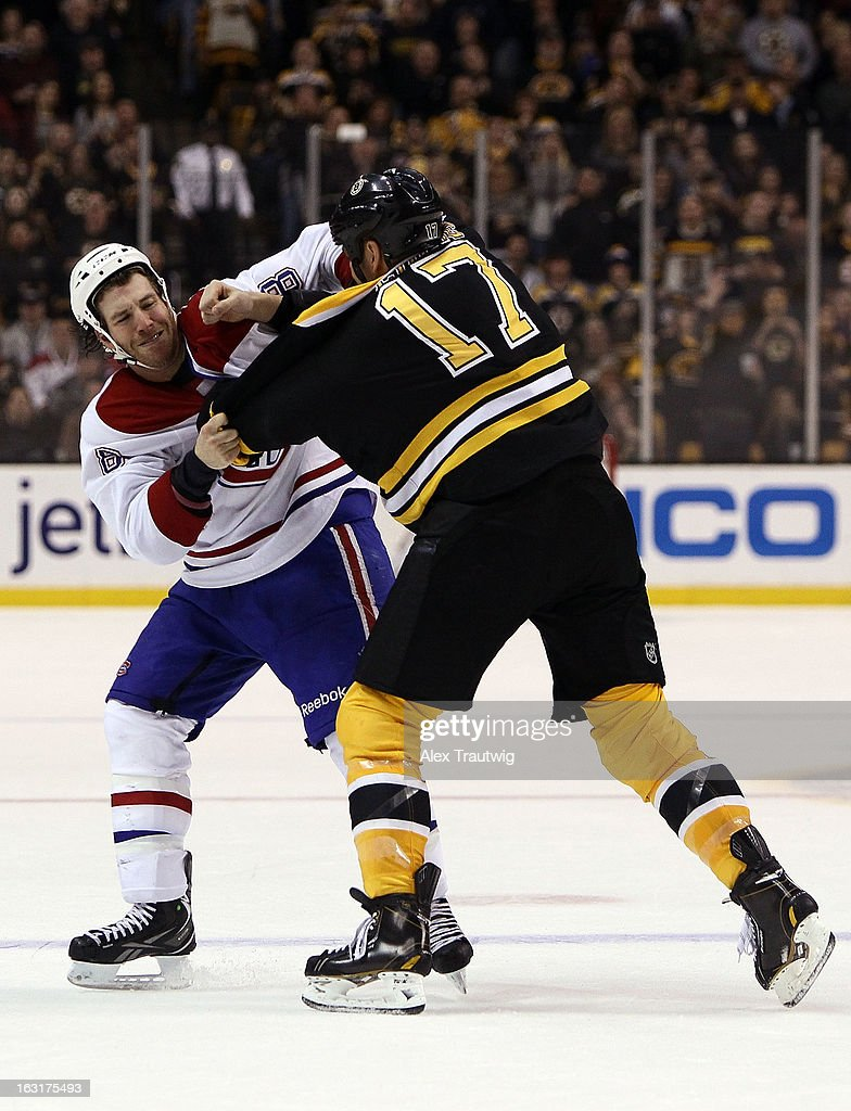 Milan Lucic #17 of the Boston Bruins and Brandon Prust #8 of the Montreal Canadiens fight during a game at the TD Garden on March 3, 2013 in Boston, Massachusetts.