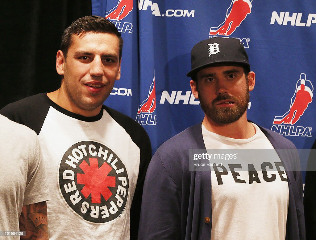 Milan Lucic of the Boston Bruins and Henrik Zetterberg of the Detroit Red Wings wait on the stage for the start of the NHLPA press conference at Marriott Marquis Times Square on September 13, 2012 in New York City.