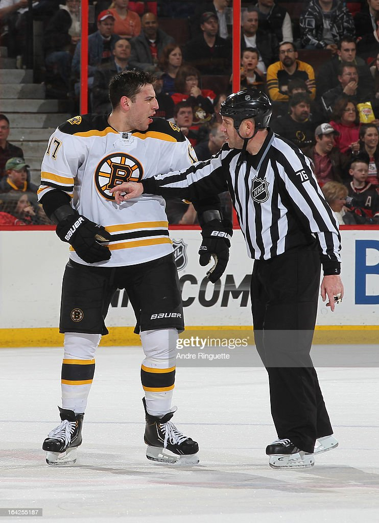 <a gi-track='captionPersonalityLinkClicked' href=/galleries/search?phrase=Milan+Lucic&family=editorial&specificpeople=537957 ng-click='$event.stopPropagation()'>Milan Lucic</a> #17 of the Boston Bruins argues with linesman Michel Cormier #76 in a game against the Ottawa Senators on March 21, 2013 at Scotiabank Place in Ottawa, Ontario, Canada.