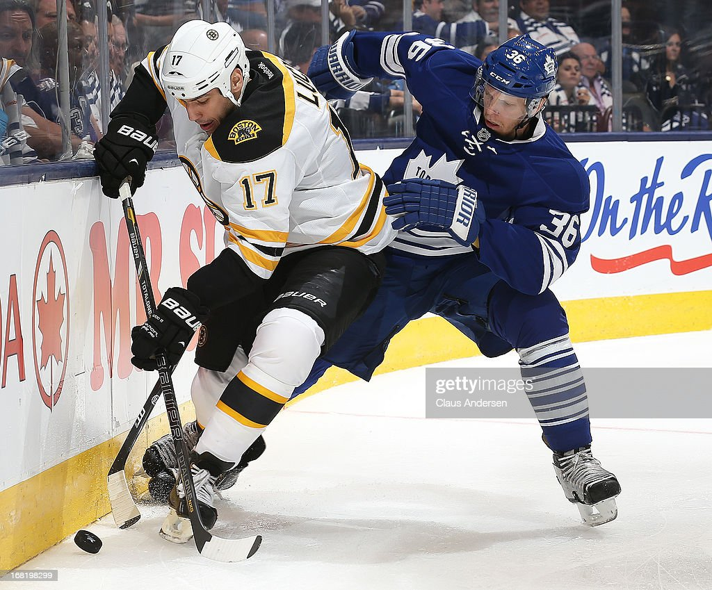 <a gi-track='captionPersonalityLinkClicked' href=/galleries/search?phrase=Milan+Lucic&family=editorial&specificpeople=537957 ng-click='$event.stopPropagation()'>Milan Lucic</a> #17 of the Boston Bruins battles against <a gi-track='captionPersonalityLinkClicked' href=/galleries/search?phrase=Carl+Gunnarsson&family=editorial&specificpeople=5557315 ng-click='$event.stopPropagation()'>Carl Gunnarsson</a> #36 of the Toronto Maple Leafs in Game Three of the Eastern Conference Quarterfinals during the 2013 Stanley Cup Playoffs on May 6, 2013 at the Air Canada Centre in Toronto, Ontario, Canada. The Bruins defeated the Leafs 5-2 to take a 2-1 series lead.