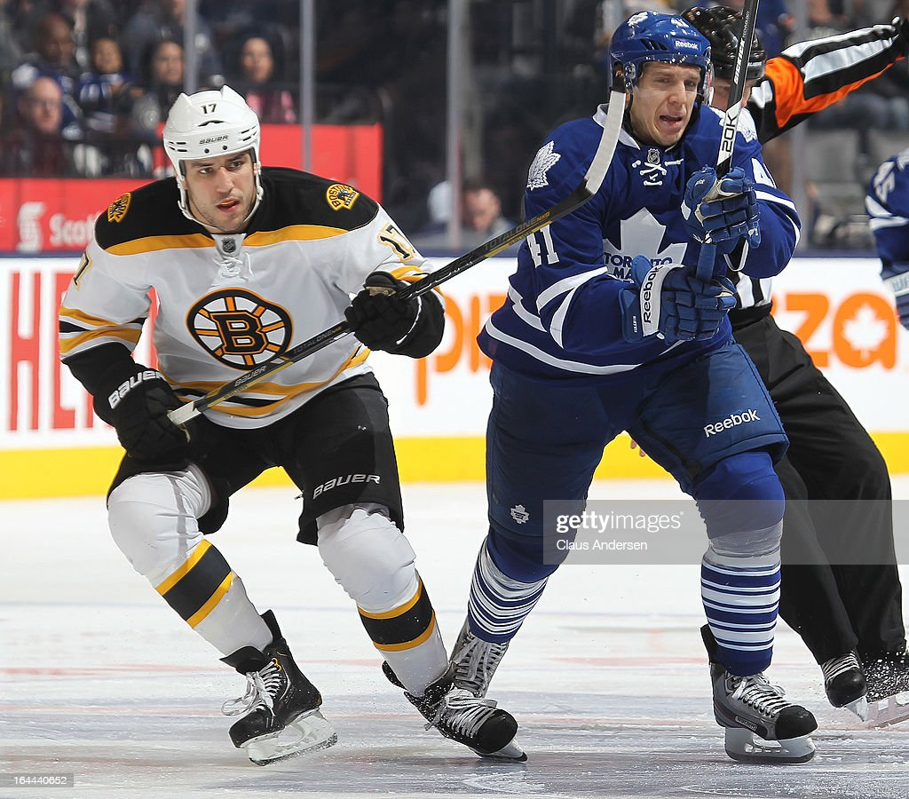 <a gi-track='captionPersonalityLinkClicked' href=/galleries/search?phrase=Milan+Lucic&family=editorial&specificpeople=537957 ng-click='$event.stopPropagation()'>Milan Lucic</a> #17 of the Boston Bruins battles against <a gi-track='captionPersonalityLinkClicked' href=/galleries/search?phrase=Nikolai+Kulemin&family=editorial&specificpeople=537949 ng-click='$event.stopPropagation()'>Nikolai Kulemin</a> #41 of the Toronto Maple Leafs in a game on March 23, 2013 at the Air Canada Centre in Toronto, Ontario, Canada. The Leafs defeated the Bruins 3-2.