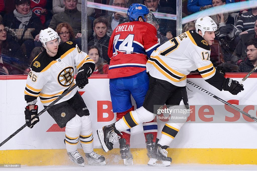Milan Lucic #17 of the Boston Bruins body checks Alexei Emelin #74 of the Montreal Canadiens during the NHL game at the Bell Centre on February 6, 2013 in Montreal, Quebec, Canada. The Bruins defeated the Canadiens 2-1.