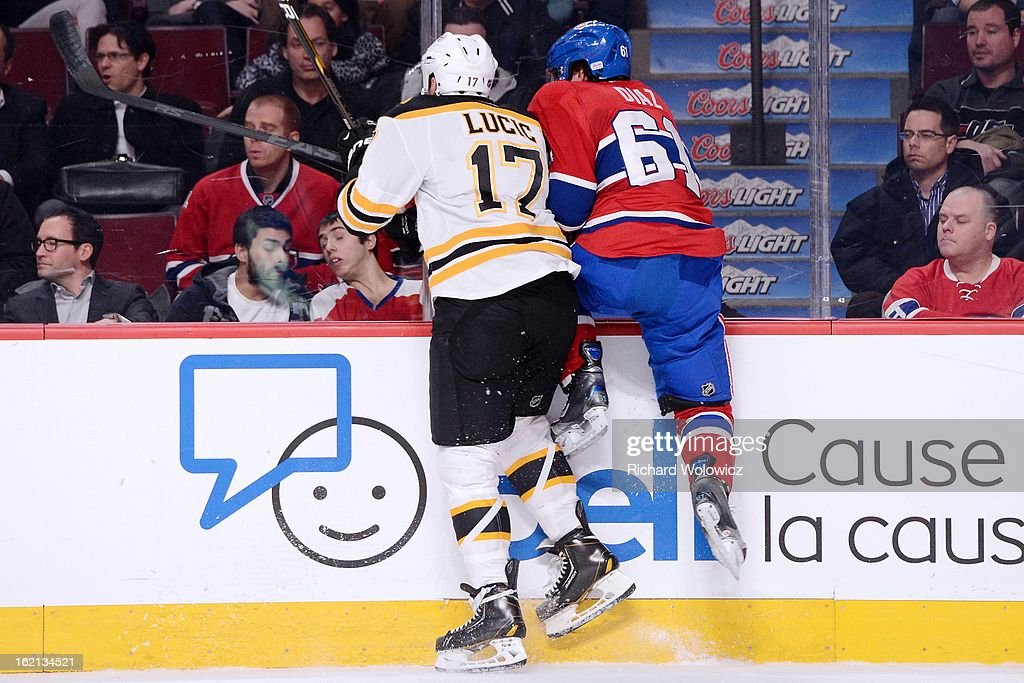 Milan Lucic #17 of the Boston Bruins body checks Raphael Diaz #61 of the Montreal Canadiens during the NHL game at the Bell Centre on February 6, 2013 in Montreal, Quebec, Canada. The Bruins defeated the Canadiens 2-1.