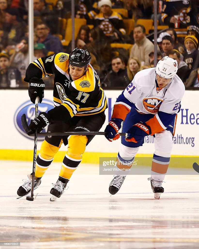 <a gi-track='captionPersonalityLinkClicked' href=/galleries/search?phrase=Milan+Lucic&family=editorial&specificpeople=537957 ng-click='$event.stopPropagation()'>Milan Lucic</a> #17 of the Boston Bruins carries the puck in front of <a gi-track='captionPersonalityLinkClicked' href=/galleries/search?phrase=Kyle+Okposo&family=editorial&specificpeople=540469 ng-click='$event.stopPropagation()'>Kyle Okposo</a> #21 of the New York Islanders during the game on January 25, 2013 at TD Garden in Boston, Massachusetts.